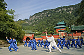 Taichi training from Wudang School of Martial Arts, in front of Purple Heaven Hall, Zi Xiao Gong,  peak 1613 metres high, Wudang Shan, Taoist mountain, Hubei province, Wudangshan, Mount Wudang, UNESCO world cultural heritage site, birthplace of Tai chi, C