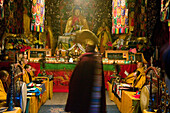 Monks in Pusa Ding temple at morning prayer, Yellow Hat sect of Tibetan Buddhism, Mount Wutai, Wutai Shan, Five Terrace Mountain, Buddhist Centre, town of Taihuai, Shanxi province, China