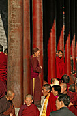 Buddhist monks attending a prayer ceremony to honour Wenshus, red columns of the temple, Xiantong Monastery, Wutai Shan, Five Terrace Mountain, Buddhist Centre, town of Taihuai, Shanxi province, China