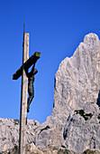 Cross in front of the north pillar of Predigtstuhl, Kaiser Mountain Range, Tyrol, Austria