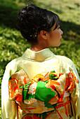 Young japanese woman in a kimono, Happo-en Garden, Tokyo, Japan