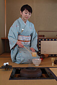Japanese Woman preparing the tea, tea ceremony in Hosomi museum, Kyoto, Japan