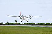 Landing Air Seychelles DHC-6 Twin Otter Airplane,Praslin Airport, Praslin Island, Seychelles