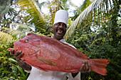 Taj Denis Island Resort Chef with Red Snapper,Denis Island, Seychelles