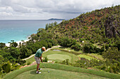 Golfer on Tee of Hole 15 at Lemuria Golf Course,Lemuria Resort of Praslin, Praslin Island, Seychelles