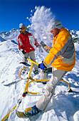 A couple having fun while snowbiking downhill,  Serfaus, Tyrol, Austria