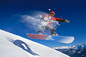 Snowboarder in mid-air after a jump, Serfaus, Tyrol, Austria