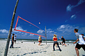 teenager playing volleyball on the beach, Eastfriesian Islands, North Sea, Germany