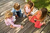 Children playing spin the bottle, children's birthday party