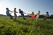 Children playing tug-of-war, children's birthday party