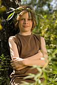 Boy wearing a leaf wreath, portrait
