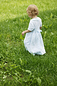 Young girl walking in field