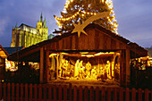 Nativity scene at Christmas market, cathedral square in the evening, Erfurt, Thuringia, Germany