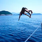 Man diving into Adriatic Sea, Dalmatia, Croatia