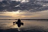 Kayaking on Okarito Lagoon at Sunset, Okarito, West Coast, South Island, New Zealand