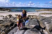 Towel-Wrapped Girls on Irish Beach, Aughrusbeg Beach, Connemara, near Cleggan, County Galway, Ireland