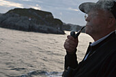 Man with Pipe Admiring Norwegian Coastline, Aboard MS Bremen Cruise Ship, Hapag-Lloyd Kreuzfahrten, Germany