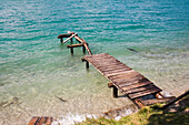 Derelict footbridge at lake, Upper Bavaria, Germany