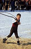 Child cracking whip, Folklore show, Wals-Siezenheim, Salzburg, Austria