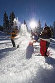 A family having fun in the snow, Kasberg, Upper Austria, Austria