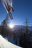 A skier, freerider performing a jump in a winter landscape, Krippenstein, Dachstein, Obertraun, Upper Austria, Austria