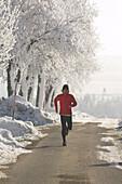 Male jogger in winter, Upper Austria