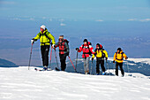 A group of skitourists climb with skis and skins to the top of the Popova Kapa in the Rila Mountains, Europe, Bulgaria, MR