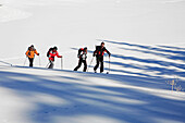 A group of skitourists climb with skis and skins to the top of the Popova Kapa in the Rila Mountains, Europe, Bulgaria