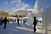 A man walks througn an ice sculpture in the ski resort of Lake Louise. This installation was build because of the world cup ski race and start of the ski season 2005. Banff Lake Louise, rocky Mountains, Alberta, Canada, North America