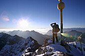 Man at the summit of the Zugspitze in the morning, Bavaria, Germany