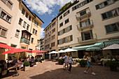 View inside Glockengasse with pavement cafes, Zurich, Canton Zurich, Switzerland