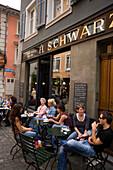 People sitting in a small pavement cafe, Rennweg, Zurich, Canton Zurich, Switzerland
