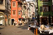 People sitting in a pavement cafe, view inside Augustinergasse, Zurich, Canton Zurich, Switzerland
