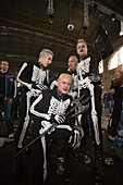 Four raver, dressed up as skeleton, at an opening in the station, Street Parade (the most attended technoparade in Europe), Zurich, Canton Zurich, Switzerland