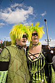 Flashy dressed up couple with yellow hairs at Street Parade (the most attended technoparade in Europe) near Quai Bridge, Zurich, Canton Zurich, Switzerland