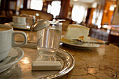 A glass of water, sugar and a cup of coffee in Cafe Tomaselli, Salzburg, Austria