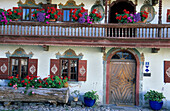 Historical farmhouse with traditional painting and flower decoration, Samerberg, Chiemgau, Bavaria, Germany
