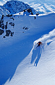 A young skier, a freerider skiing in powder snow at the Parsenn Skiarea, Davos, Klosters, Grisons, Graubuenden, Switzerland, Europe, Alps