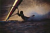 Windsurfer splashing into the water, bodydrag