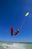 Man kiteboarding, big jump