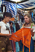 Two young women in a shop for traditional Bavarian clothes, Schwabing, Munich, Bavaria, Germany