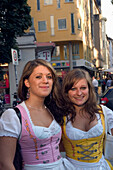 Girls wearing traditional Bavarian style dresses called Dirndl, Leopold Street, Schwabing, Munich, Bavaria, Germany
