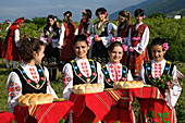 Young women in traditional costumes at Rose Festival, Karlovo, Bulgaria, Europe