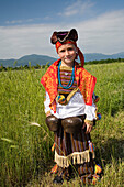 Boy in traditional costume with bells, Rose Festival, Karlovo, Bulgaria, Europe