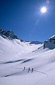 Three back-country skier in valley Pollestal, Oetztal Range, Tyrol, Austria