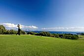 Senior man playing golf, Club de Golf Alcanada, Badia de Alcudia, Majorca, Spain