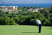 Golf player on a golf course, Real Golf de Bendinat, Majorca, Balearic Islands, Spain, Europe
