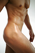 Mid section of a naked young man