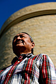 A Native American outside the National Museum of the American Indian, Washington DC, United States, USA