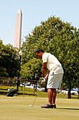 A man playing golf, East Potomac Golf Course, Washington DC, United States, USA